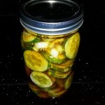 Packing the cucumbers in the jar bread and butter pickles